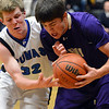 Holy Family's Devlin Granberg steals the ball from Peak to Peak's Andrew Otey during Friday's boys game at Peak to Peak.<br /> January 25, 2013<br /> staff photo/ David R. Jennings