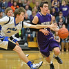 Holy Family's Chuck Hollwedel dribbles the ball down court as Peak to Peak's Max Clark reaches to try and steal the ball during over time in Friday's boys game at Peak to Peak.<br /> January 25, 2013<br /> staff photo/ David R. Jennings