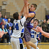 Holy Family's David Sommers shoots the ball against Peak to Peak's Sam Fangman during Friday's boys game at Peak to Peak.<br /> January 25, 2013<br /> staff photo/ David R. Jennings