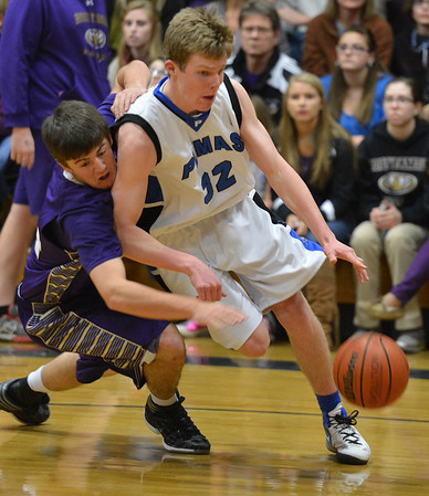 Peak to Peak's Andrew Otey dribbles the ball against  Holy Family's Devlin Granberg during Friday's boys game at Peak to Peak.<br /> January 25, 2013<br /> staff photo/ David R. Jennings