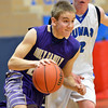 Holy Family's David Sommers dribbles the ball downcourt against Peak to Peak's Andrew Otey during Friday's boys game at Peak to Peak.<br /> January 25, 2013<br /> staff photo/ David R. Jennings