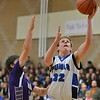 Peak to Peak's Andrew Otey rebounds the ball against Holy Family's Devlin Granberg during Friday's boys game at Peak to Peak.<br /> January 25, 2013<br /> staff photo/ David R. Jennings