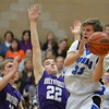 Peak to Peak's Max Clark passes the ball around Holy Family's David Sommers during Friday's boys game at Peak to Peak.<br /> January 25, 2013<br /> staff photo/ David R. Jennings