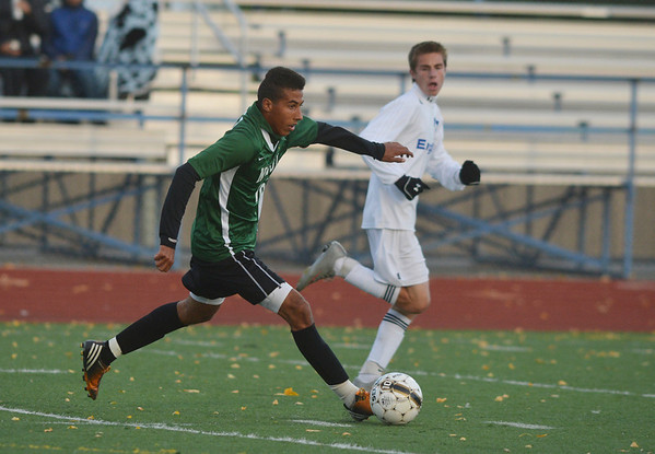 Niwot's Alexander Merritt takes the ball downfield against Broomfield during Thursday's game at Elizabeth Kennedy Stadium.<br /> October 4, 2012<br /> staff photo/ David R. Jennings