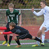Niwot's goalie Jack Fitzgerald saves the ball against Broomfield's Clay Fiscus (24) during Thursday's game at Elizabeth Kennedy Stadium.<br /> October 4, 2012<br /> staff photo/ David R. Jennings