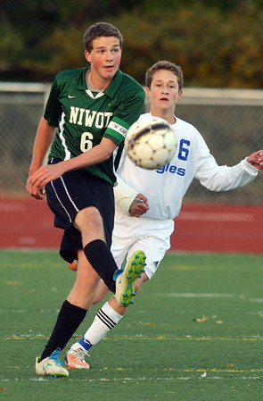 Niwot's Grant Webster moves the ball downfield away from Broomfield's Porter Milner during Thursday's game at Elizabeth Kennedy Stadium.<br /> October 4, 2012<br /> staff photo/ David R. Jennings