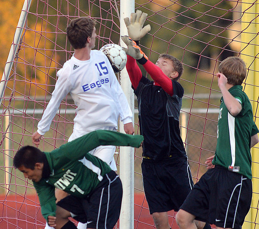 Broomfield's Connor Metzger (15) does a header towards the goal against Niwot's goalie Jack Fitzgerald during Thursday's game at Elizabeth Kennedy Stadium.<br /> October 4, 2012<br /> staff photo/ David R. Jennings