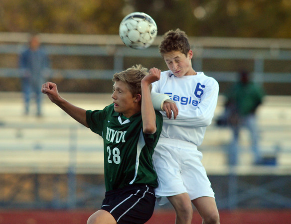 Niwot's Billy Hoffman , left, (28) and Broomfield's Porter Milner collide while fighting for control of the ball during Thursday's game at Elizabeth Kennedy Stadium.<br /> October 4, 2012<br /> staff photo/ David R. Jennings