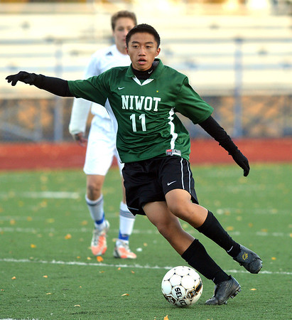 Niwot's Pampoan Xiong  takes the ball downfield against Broomfield during Thursday's game at Elizabeth Kennedy Stadium.<br /> October 4, 2012<br /> staff photo/ David R. Jennings