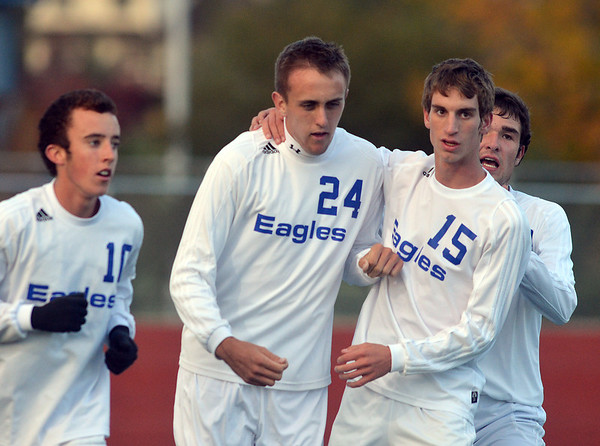 Broomfield's Clay Fiscus (24), center,  celebrates his goal against Niwot, with teammates Noah Chapleski, left, and Connor Metzger during Thursday's game at Elizabeth Kennedy Stadium.<br /> October 4, 2012<br /> staff photo/ David R. Jennings