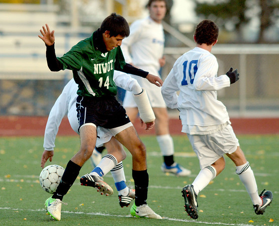 Niwot's Carlos Dominguez ( 14) fights for control of the ball with Broomfeild during Thursday's game at Elizabeth Kennedy Stadium.<br /> October 4, 2012<br /> staff photo/ David R. Jennings