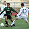 Niwot's Pampoan Xiong (11) fights for control of the ball against Broomfield's Noah Chapleski during Thursday's game at Elizabeth Kennedy Stadium.<br /> October 4, 2012<br /> staff photo/ David R. Jennings