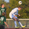 Broomfield's Clay Fiscus does a header against Niwot's Grant Webster (6) during Thursday's game at Elizabeth Kennedy Stadium.<br /> October 4, 2012<br /> staff photo/ David R. Jennings