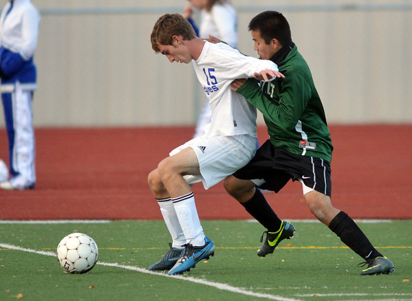 Broomfield's Connor Metzger, left,  fights for control of the ball against Niwot's Aldair Cintora  during Thursday's game at Elizabeth Kennedy Stadium.<br /> October 4, 2012<br /> staff photo/ David R. Jennings