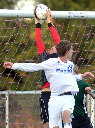 Niwot's  goalie Jack Fitzgerald makes a save from Broomfield's Connor Metzger during Thursday's game at Elizabeth Kennedy Stadium.<br /> October 4, 2012<br /> staff photo/ David R. Jennings