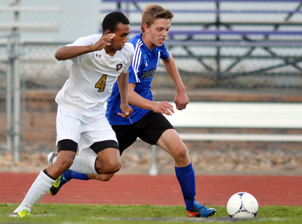 Holy Family's Nick Rhoden, left, fights for control of the ball against Peak to Peak's Ben Pagel during Thursday's game at Mike G. Gabriel Stadium<br /> September 27, 2012<br /> staff photo/ David R. Jennings