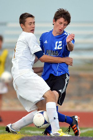 Holy Family's Matt O'Hayre collides with Peak to Peak's David Griffith during Thursday's game at Mike G. Gabriel Stadium<br /> September 27, 2012<br /> staff photo/ David R. Jennings