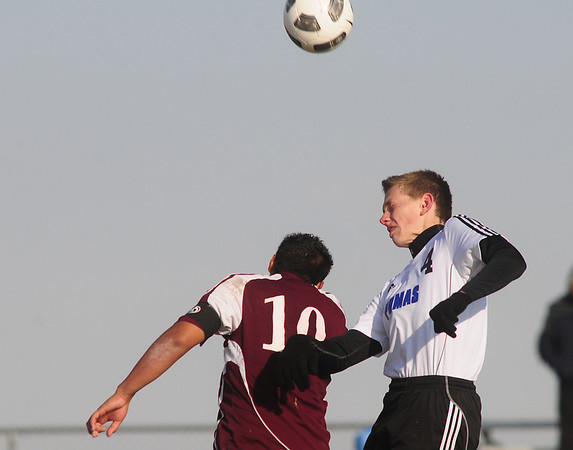 Peak to Peak's Ben Pagel goes up for a header  against Bruce Randolph's Ernesto Piedra Jara during Friday's state playoff game at Mike G. Gabriel Stadium.<br /> October 25, 2012<br /> staff photo/ David R. Jennings