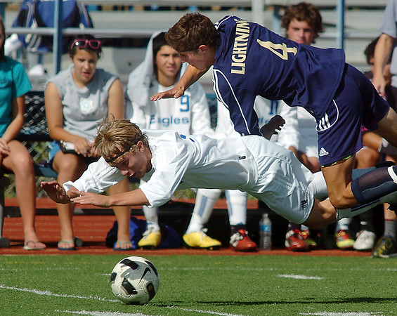 "Broomfield's Thomas O'Brien and Legacy's Brian ""Danny"" Mooney collide during Saturday's game at Elizabeth Kennedy Stadium.<br /> September 24, 2011<br /> staff photo/ David R. Jennings"