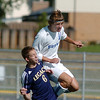 Broomfield's Trevor Sackman goes for a header over Legacy's Danny Faught during Saturday's game at Elizabeth Kennedy Stadium.<br /> September 24, 2011<br /> staff photo/ David R. Jennings