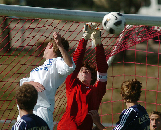 Legacy's keeper Garrett Hernandez keeps the ball from the goal after an attempt by Broomfield's Connor Metzger during Saturday's game at Elizabeth Kennedy Stadium.<br /> September 24, 2011<br /> staff photo/ David R. Jennings