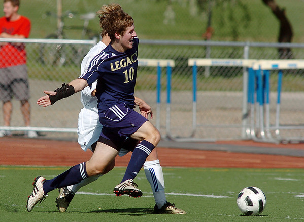 """Legacy's John """"Gib"""" Hyatt fights for control of the ball with Broomfield's Trevor Sackman  during Saturday's game at Elizabeth Kennedy Stadium.<br /> September 24, 2011<br /> staff photo/ David R. Jennings"""