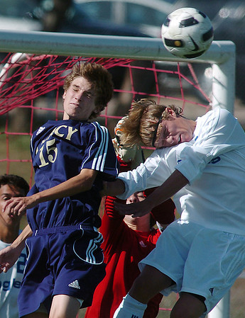 Legacy's Kyle Morrow, left, and Broomfield's Thomas O'Brien do headers at the Legacy goal during Saturday's game at Elizabeth Kennedy Stadium.<br /> September 24, 2011<br /> staff photo/ David R. Jennings