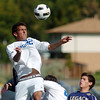 Broomfield's Colton Lamb goes to the air for a header past Legacy during Saturday's game at Elizabeth Kennedy Stadium.<br /> September 24, 2011<br /> staff photo/ David R. Jennings