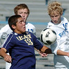 Legacy's Jacob Gonzales fights for control of the ball with Broomfield's Tim Ayers and Jake Bellendir during Saturday's game at Elizabeth Kennedy Stadium.<br /> September 24, 2011<br /> staff photo/ David R. Jennings