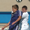 Legacy's Nick Smith and Broomfield's Nick Saunders go up for a header during Saturday's game at Elizabeth Kennedy Stadium.<br /> September 24, 2011<br /> staff photo/ David R. Jennings