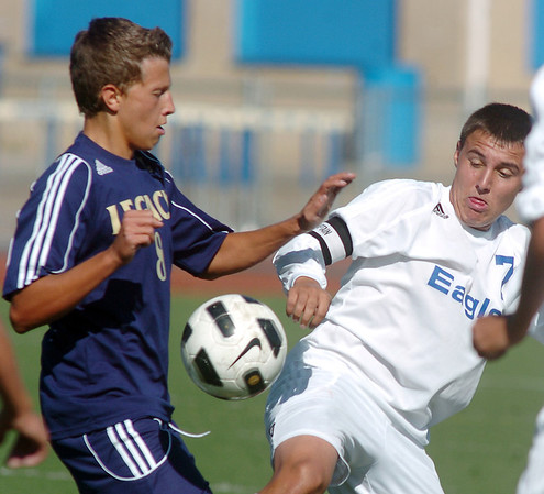 Legacy's Nick Amith, left, battles Broomfield's Nick Saunders for control of the ball during Saturday's Broomfield vs. Legacy soccer game at Elizabeth Kennedy Stadium.<br /> September 24, 2011<br /> staff photo/ David R. Jennings
