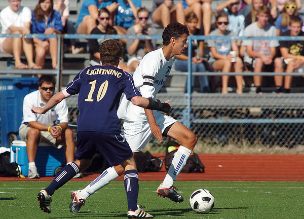 "Broomfield's Colton Lamb moves the ball away from Legacy's John ""Gib"" Hyatt during Saturday's game at Elizabeth Kennedy Stadium.<br /> September 24, 2011<br /> staff photo/ David R. Jennings"