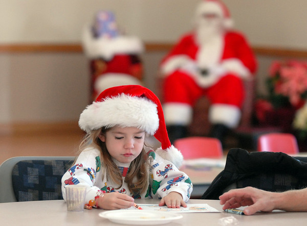 BE1205break07<br /> Lauren Weiss, 7, colors a picture for Santa during the Broomfield Lions Club Breakfast with Santa on Saturday at the Broomfield Community Center.<br /> <br /> December 4, 2010<br /> staff photo/David R. Jennings