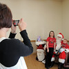 BE1205break02<br /> Gennifer Clapper, left, takes a picture of her son Reilly Clapper, 18 months, and Kaitlyn Pattison, 11, with Santa during the Broomfield Lions Club Breakfast with Santa on Saturday at the Broomfield Community Center.<br /> <br /> December 4, 2010<br /> staff photo/David R. Jennings