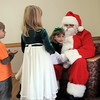 BE1205break09<br /> Olivia Nichols, 7, gives Santa a hug while Jackson Nichols, 6, and Shannon Jones, 6 1/2, wait their turn during the Broomfield Lions Club Breakfast with Santa on Saturday at the Broomfield Community Center.<br /> <br /> December 4, 2010<br /> staff photo/David R. Jennings