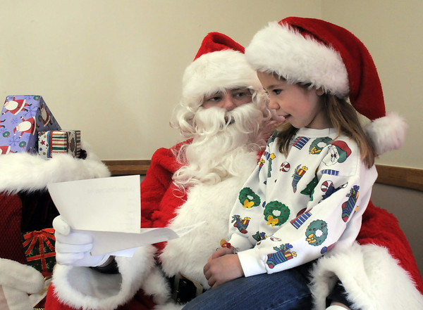 BE1205break01<br /> Lauren Weiss, 7, taks with Santa about her long list she gave him to look over during the Broomfield Lions Club Breakfast with Santa on Saturday at the Broomfield Community Center.<br /> <br /> December 4, 2010<br /> staff photo/David R. Jennings