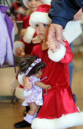 Julia Stanley, 2 1/2, holds her grandfather's hand while waiting to visit Santa at the 10th annual Broomfield Lions Club, Breakfast with Santa at the Broomfield Community Center on Saturday.<br /> December 5, 2009<br /> Staff photo/David R. Jennings
