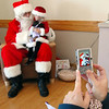 Julia Stanley, 2 1/2, has her picture takes while visiting with Santa at the 10th annual Broomfield Lions Club Breakfast with Santa at the Broomfield Community Center on Saturday.<br /> December 5, 2009<br /> Staff photo/David R. Jennings