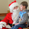 Porter Brinkmann, 6 1/2. visits with Santa at the 10th annual Broomfield Lions Club Breakfast with Santa at the Broomfield Community Center on Saturday.<br /> December 5, 2009<br /> Staff photo/David R. Jennings