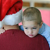 Alexander Jezierski, 3 1/2, takes a break on his father's shoulders after visiting Santa at the 10th annual Broomfield Lions Club Breakfast with Santa at the Broomfield Community Center on Saturday.<br /> December 5, 2009<br /> Staff photo/David R. Jennings