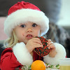 Julia Stanley, 2 1/2, eats a doughnut at 10th annual Broomfield Lions Club, Breakfast with Santa at the Broomfield Community Center on Saturday.<br /> December 5, 2009<br /> Staff photo/David R. Jennings