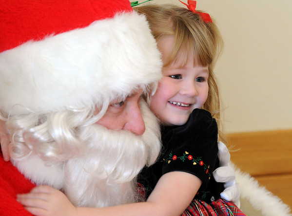 Lileana Clark, 4, gives Santa a hug during the 10th annual Broomfield Lions Club Breakfast with Santa at the Broomfield Community Center on Saturday.<br /> December 5, 2009<br /> Staff photo/David R. Jennings