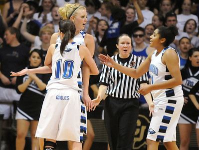Bre Burgesser is held by Autumn Chase and comforted by Tyana Medema after Burgesser fouled out of the game against Longmont  for the class 4A championship at the Coors Events Center in Boulder on Friday.   March 12, 2010 Staff photo/David R. Jennings