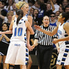 Bre Burgesser is held by Autumn Chase and comforted by Tyana Medema after Burgesser fouled out of the game against Longmont  for the class 4A championship at the Coors Events Center in Boulder on Friday.<br /> <br /> <br /> March 12, 2010<br /> Staff photo/David R. Jennings