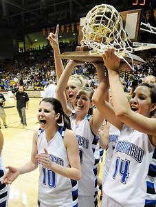 Autumn Chase, left, Millie Reeves hold the state trophy with Katie Nehf   and Bre Brugesser after winning Broomfield's 4th state championship  by defeating Longmont 55 to 47 in the class 4A championship game at the Coors Events Center in Boulder on Friday.    March 10, 2010 Staff photo/David R. Jennings