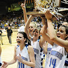 Autumn Chase, left, Millie Reeves hold the state trophy with Katie Nehf   and Bre Brugesser after winning Broomfield's 4th state championship  by defeating Longmont 55 to 47 in the class 4A championship game at the Coors Events Center in Boulder on Friday.<br /> <br /> <br /> <br /> March 10, 2010<br /> Staff photo/David R. Jennings