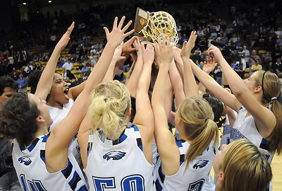 Broomfield girls reach to touch the state class 4A championship trophy winning their 4th straight at the Coors Events Center in Boulder on Friday.   March 10, 2010 Staff photo/David R. Jennings