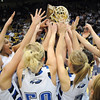 Broomfield girls reach to touch the state class 4A championship trophy winning their 4th straight at the Coors Events Center in Boulder on Friday.<br /> <br /> <br /> March 10, 2010<br /> Staff photo/David R. Jennings