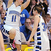 Broomfield's Kody Bradfield, left, jumps in the air while celebrating with Millie Reeves as the Eagles win their 4th straight class 4A championship against Longmont at the Coors Events Center in Boulder on Friday.<br /> <br /> <br /> <br /> March 12, 2010<br /> Staff photo/David R. Jennings