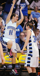 Broomfield's Kody Bradfield, left, jumps in the air while celebrating with Millie Reeves as the Eagles win their 4th straight class 4A championship against Longmont at the Coors Events Center in Boulder on Friday.    March 12, 2010 Staff photo/David R. Jennings